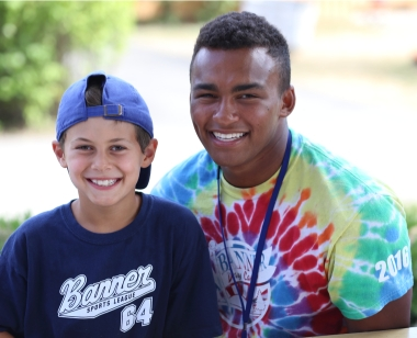 Camper smiling with a counselor