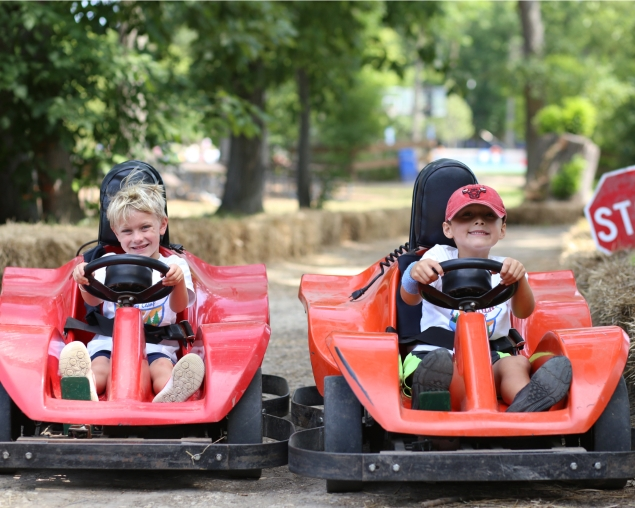 Campers driving go-karts