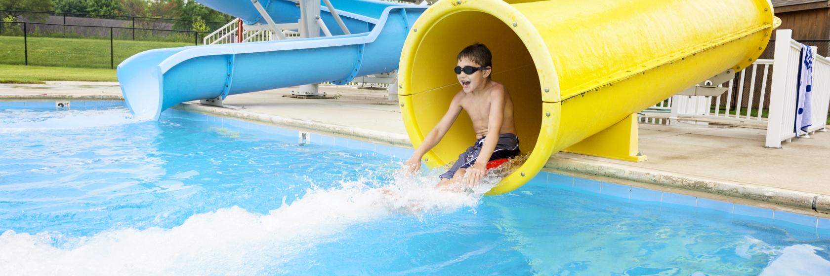 Camper sliding down a water slide