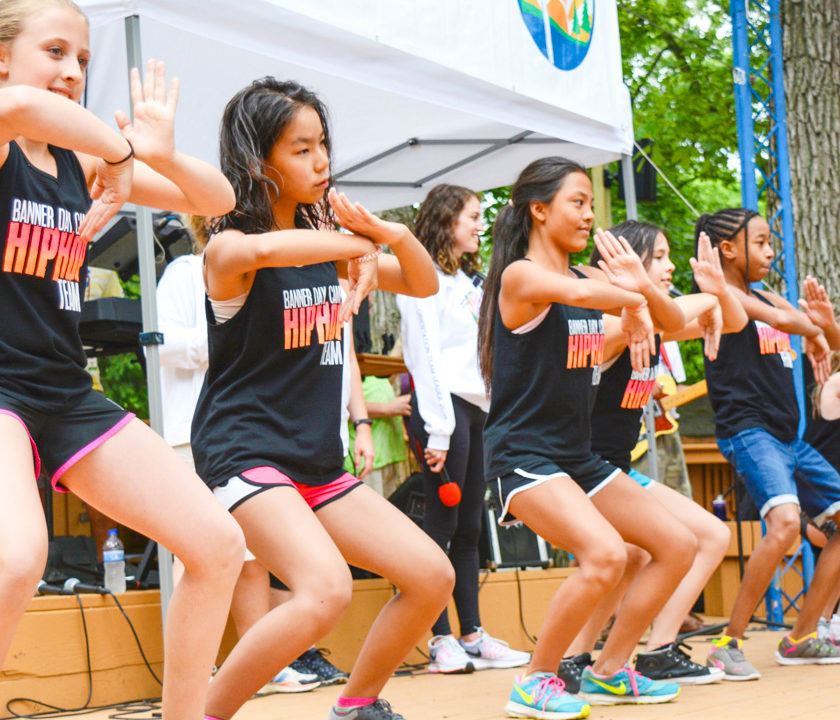 Group of girl campers dancing on stage