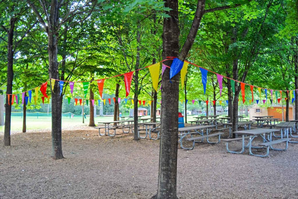 Outdoor eating area with colored flags surrounding