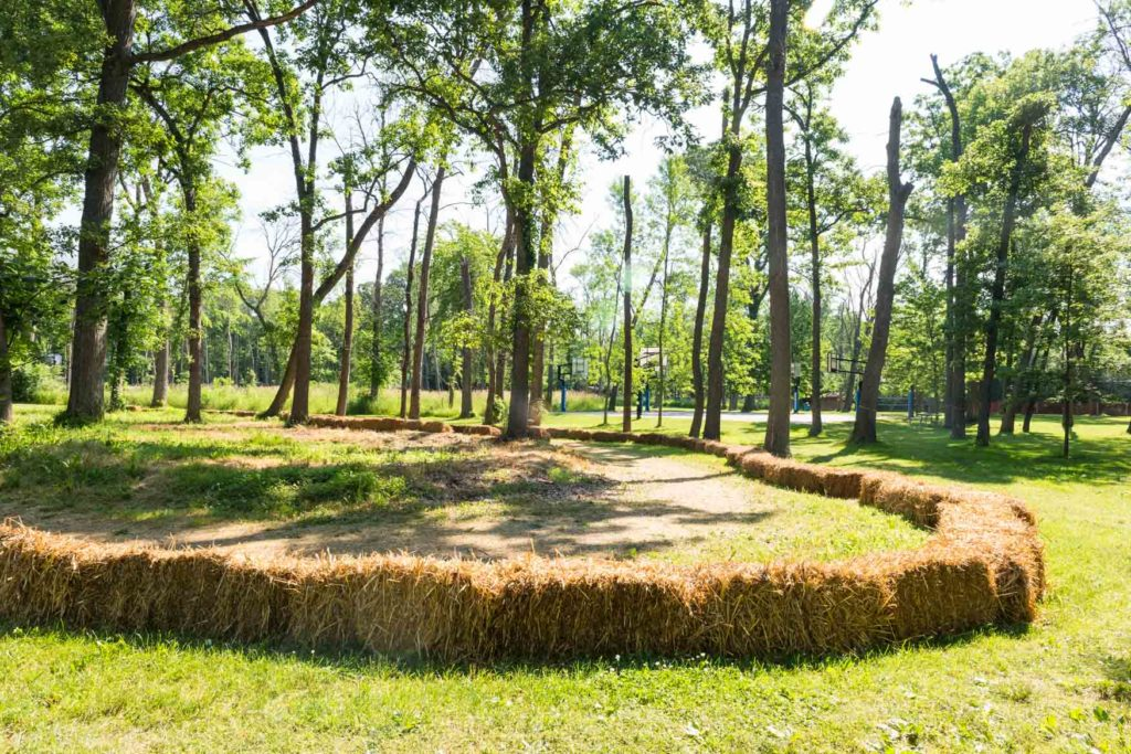 The go kart track surrounded by hay bales