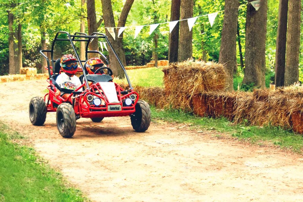 Two people in a red dune buggy