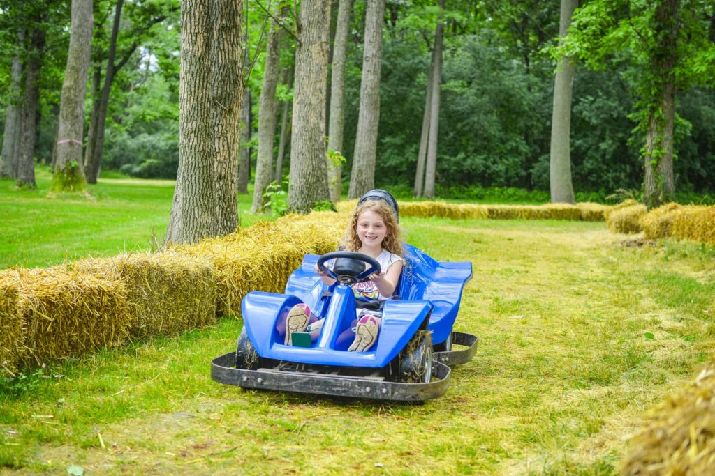 A young girl in a go kart