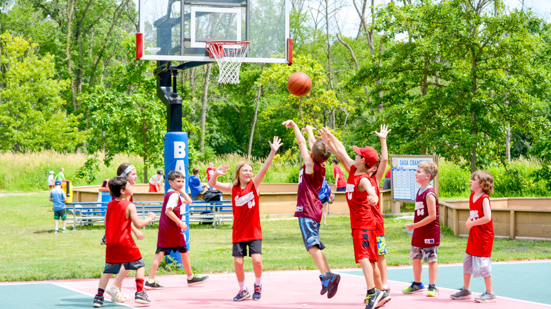 Campers playing a game of basketball