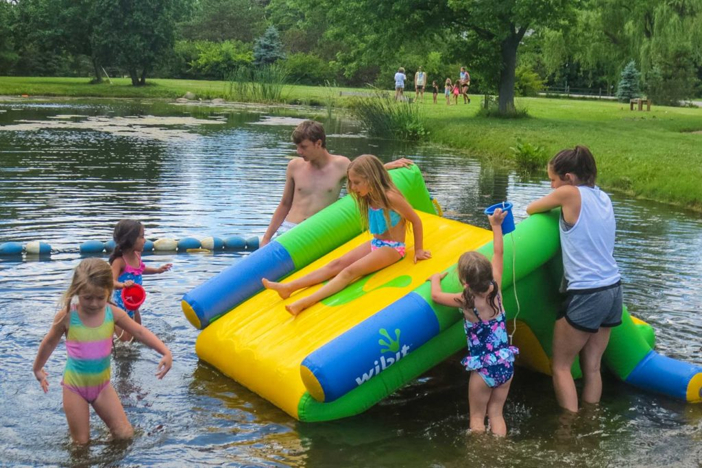 Young campers on an inflatable slide