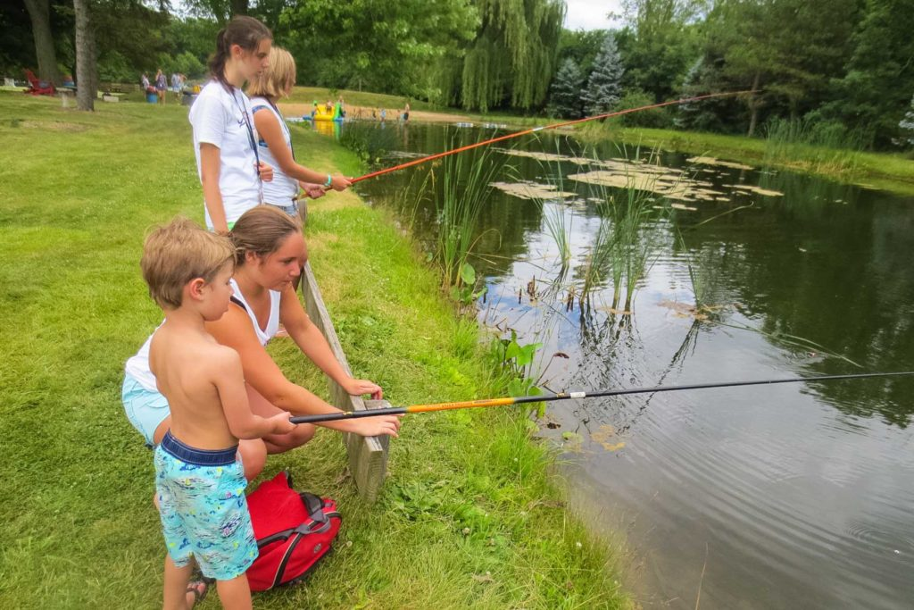 Campers and counselors going fishing at the junior lake