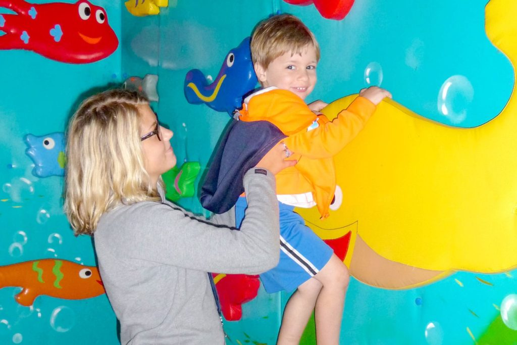 A counselor hoisting a 'super camper' to fly