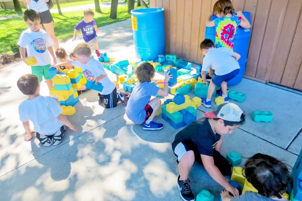 Campers playing with blue blocks