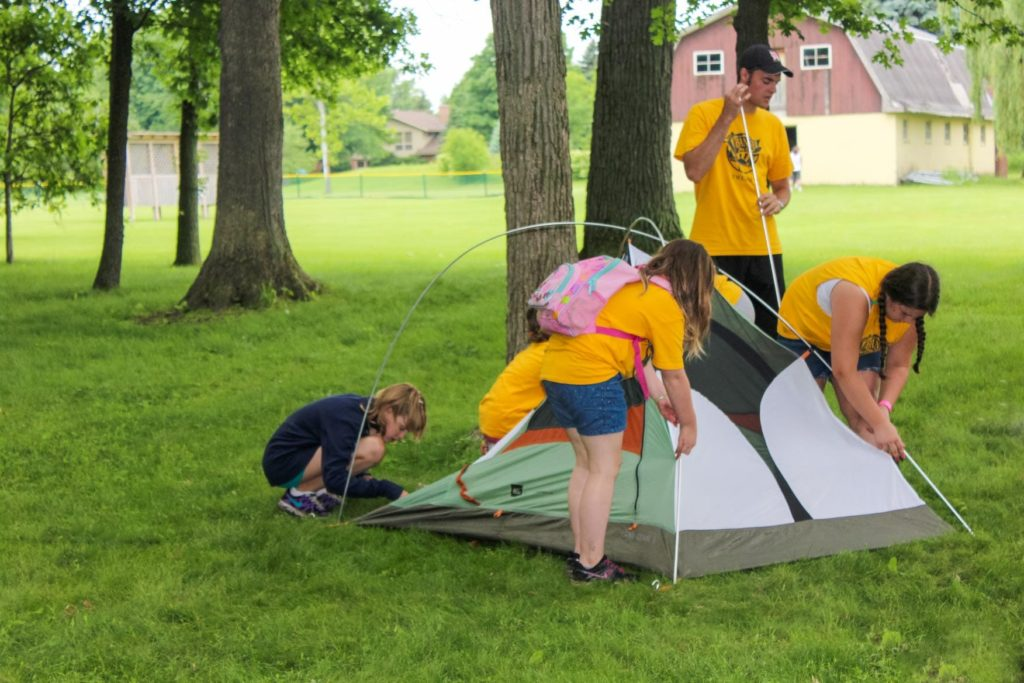 campers pitching a tent