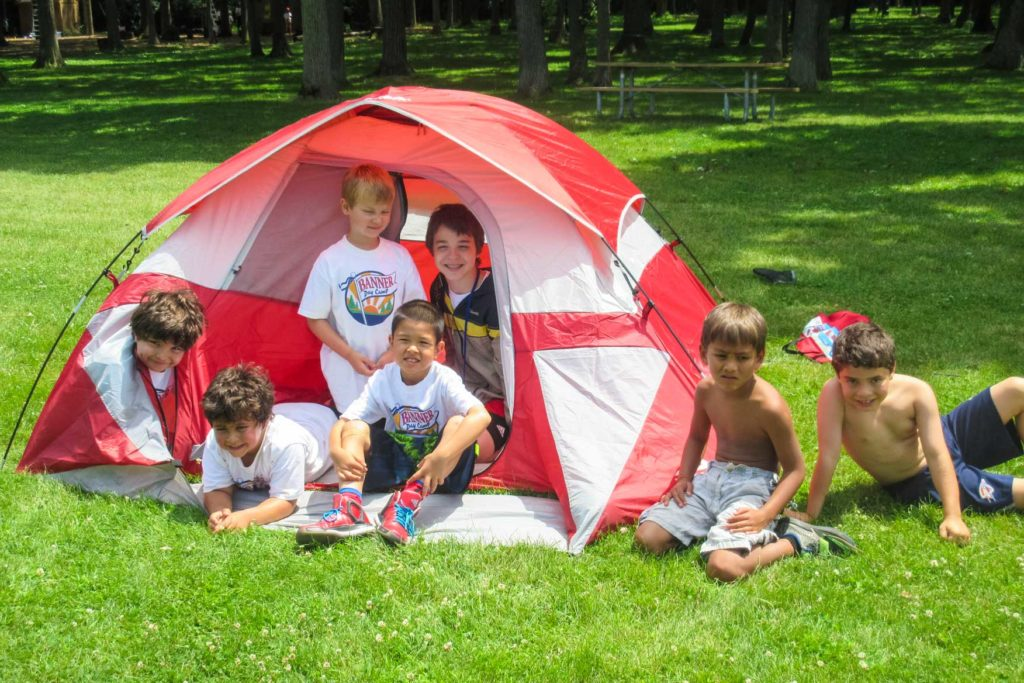 campers in an orange tent