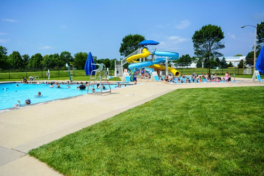 a busy pool day at the pool complex