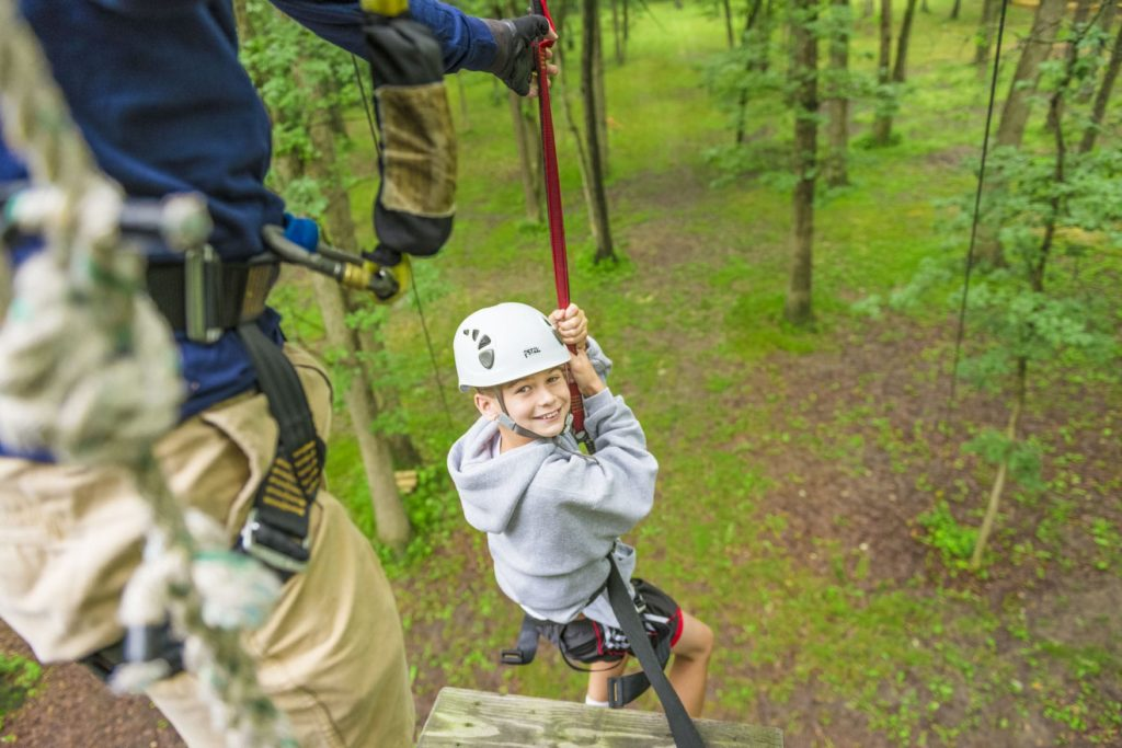 A camper on the ropes course