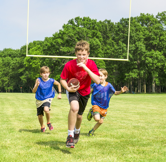 Boy campers playing flag football