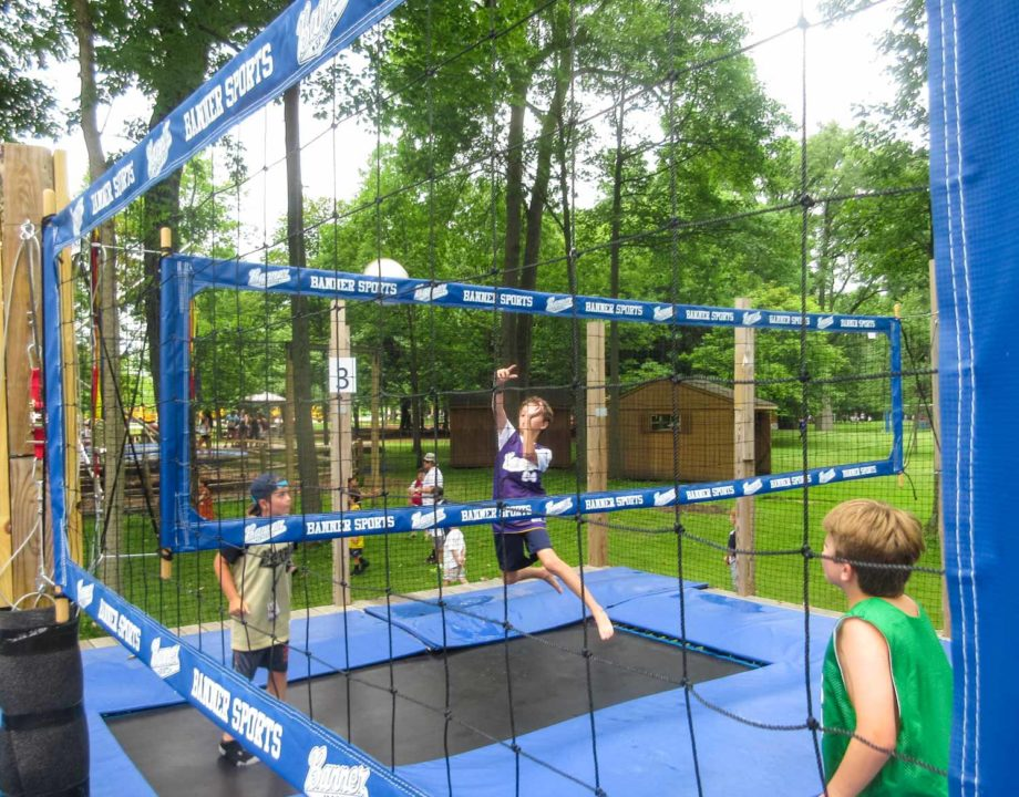Tramp ball field with trampolines and a net