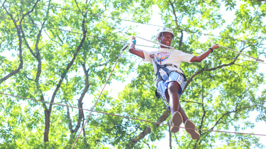 Boy camper walking the ropes course